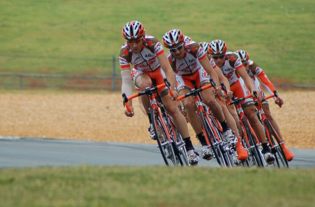 Team riding bikes on a team time trial race